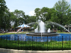 A fountain, flanked by a carousel and mini golf course, is the centerpiece of Franklin Square. (Credit: Timothy McLaughlin)
