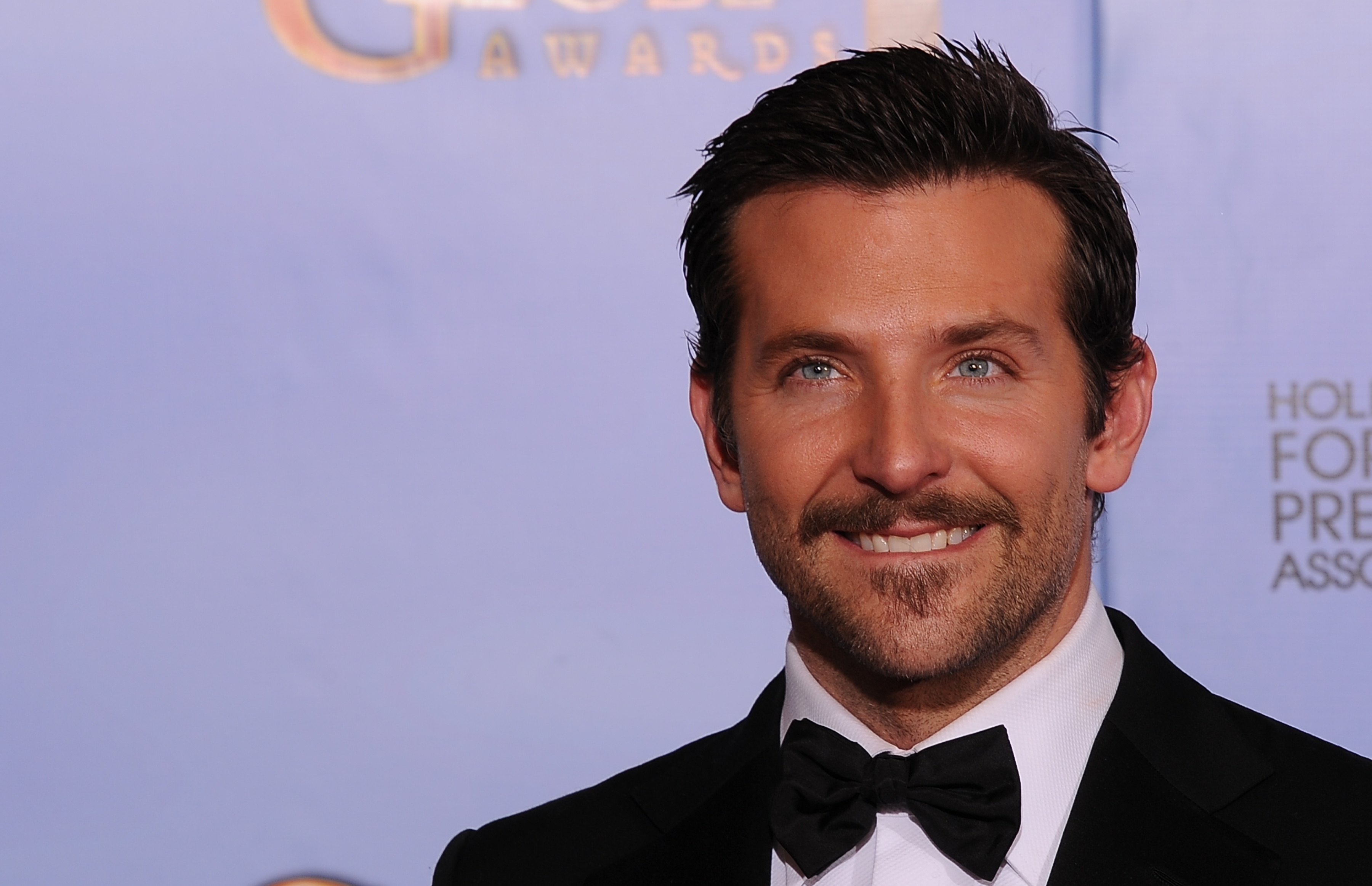 Actor Bradley Cooper poses for the press during the 69th annual Golden Globe Awards at the Beverly Hilton Hotel in Beverly Hills, California, January 15, 2012. (Credit ROBYN BECK/AFP/Getty Images)