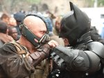 "(Tom Hardy as Bane battles Christian Bale as Batman in ""The Dark Knight Rises."")"