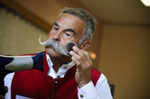 A competitor gets prepared prior to go on stage during the first edition of the European Beard and Moustache championships on September 22, 2012 in Wittersdorf, eastern France.  (Credit: SEBASTIEN BOZON/AFP/GettyImages)