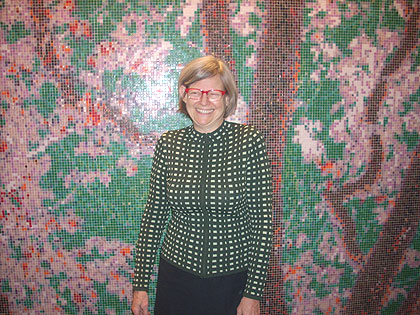 (Artist va Blitz stands in front of her mosaic at Philadelphia International AIrport.  Photo by Michelle Durham)