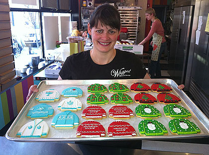 """(Zoe Lukas of Whipped bakeshop with some of her """"ugly holiday sweater cookies.""""   Credit: Hadas Kuznits)"""