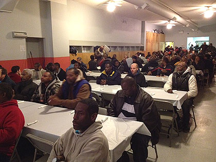 (It's a full house for an evening prayer meal served by Chosen 300 Ministries. Credit: Cherri Gregg)