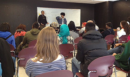 (Youth practicing their poetry delivery at a weekend workshop at Science Leadership Academy. Credit: Cherri Gregg)