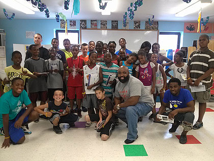 (Darren Laws, front, with some of the young people served by The Mission. Photo provided)