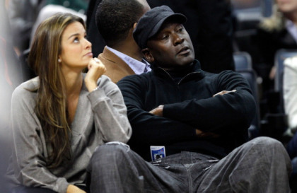Michael Jordan sits beside fiance, Yvette Prieto during a game between the Chicago Bulls and the Charlotte Bobcats at Time Warner Cable Arena. (Photo by Streeter Lecka/Getty Images)