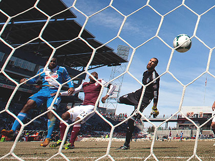 (Amobi Okugo, left, heads the ball in for a goal past Marvell Wynne and goalkeeper Matt Pickens of the Colorado Rapids on March 10th. Credit: Justin Edmonds/ Getty Images)