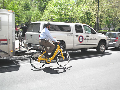 (Mayor Nutter tries out one of the sample bike-share vehicles near Rittenhouse Square.  Credit: Steve Tawa)