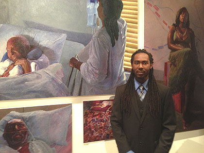 (Arcmanoro Nales stands in front of some of his paintings in the PAFA exhibition.  Credit: Mark Abrams)
