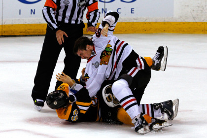 Andrew Shaw and Brad Marchand  (Photo by Jim Rogash/Getty Images)