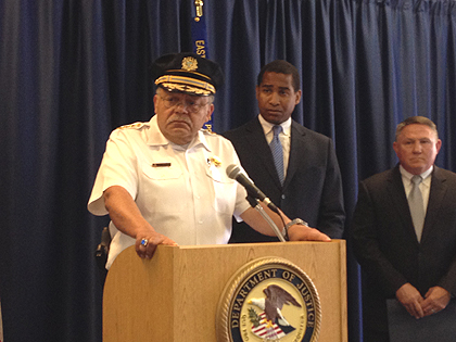 (Officials from the US attorney's office in Philadelphia listen as Commissioner Charles Ramsey speaks to reporters.  Credit: Tony Hanson)