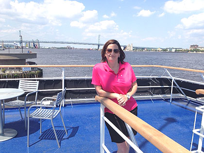 (Mary Rinaldo poses on the outdoor upper deck of the Spirit of Philadelphia.  Photo provided)