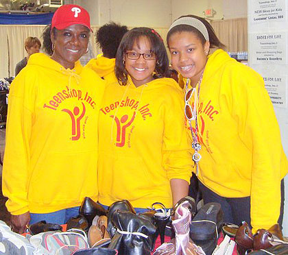 "(Elleanor Jean Hendley, left, with some young Teenshop volunteers at the ""Shoes for Life"" community service project.  Photo provided)"