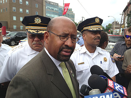 (Philadelphia mayor Michael Nutter speaks with reporters outside Temple Hospital.  Behind him are police commissioner Charles Ramsey and deputy commissioner Richard Ross.  Credit: John Ostapkovich)