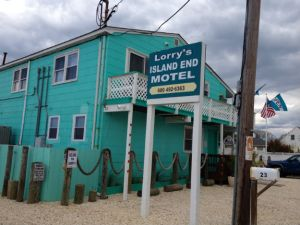 A Sandy-damaged hotel, owned by Bill Hutson, was repaired in time for the summer tourism season. (Credit: David Madden)