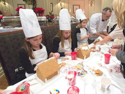 (Davio's pastry chef, Thomas Heck, far right, works with some future chefs on their gingerbread houses at last year's event.  Photo provided)