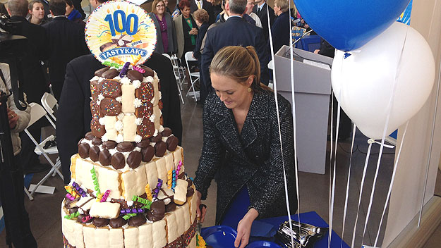 (A 100th-anniversary cake is made from a variety of Tastykake products.  Photo by John Ostapkovich)