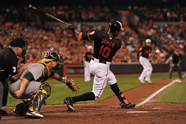 BALTIMORE, MD - AUGUST 23: Adam Jones #10 of the Baltimore Orioles hits an RBI against the Oakland Athletics in the seventh inning at Oriole Park at Camden Yards on August 23, 2013 in Baltimore, Maryland. The Baltimore Orioles won, 9-7.