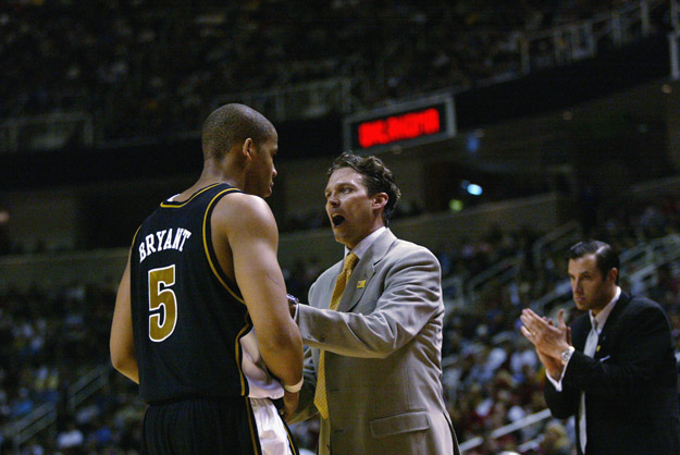 SAN JOSE, CA - MARCH 23:  Head coach Quin Snyder talks to Travon Bryant #5 of the Missouri Tigers during a break in the West Regional Final of the 2002 NCAA Men's Basketball Tournament against the Oklahoma Sooners on March 23, 2002 at Compaq Center in San Jose, California.  The Sooners won 81-75.