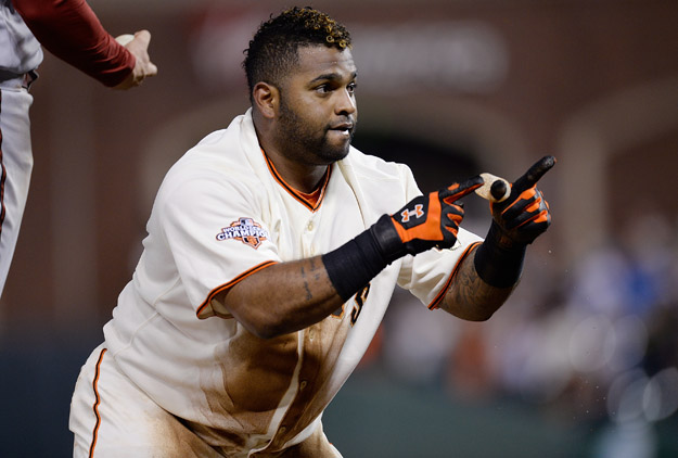 SAN FRANCISCO, CA - SEPTEMBER 05:  Pablo Sandoval #48 of the San Francisco Giants celebrates at third base after he hit an RBI triple scoring Hunter Pence #8 in the fourth inning against the Arizona Diamondbacks at AT&T Park on September 5, 2013 in San Francisco, California.