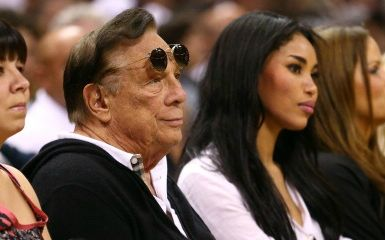 Donald Sterling and V. Stiviano (Photo by Ronald Martinez/Getty Images)