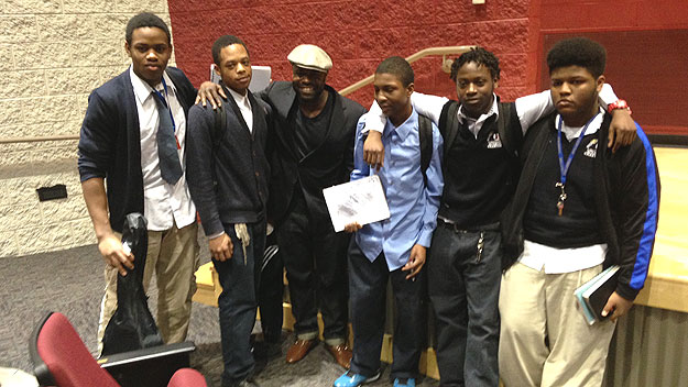 "(Tariq ""Black Thought"" Trotter poses with kids from Audenreid Charter High School, 33rd and Tasker, where press conference announcing mural took place.  Photo by Cherri Gregg)"