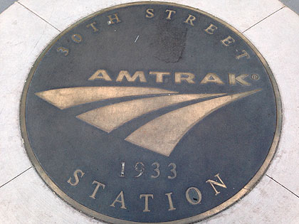 (A plaque set in a sidewalk near 30th Street Station marks its completion year, 1933.  File photo by John Ostapkovich)