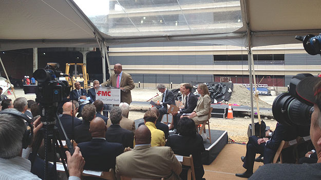 (Mayor Nutter, at lectern, addresses those gathered for the ceremonial groundbreaking of the new FMC Tower, already under construction.  Photo by John McDevitt)
