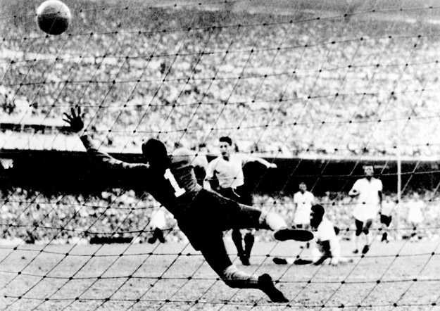RIO DE JANEIRO, BRAZIL - JULY 16:  Uruguayan forward Juan Alberto Schiaffino (C) kicks the ball past Brazilian goalkeeper Moacyr Barbosa to tie the score at 1 during the World Cup final round soccer match between Uruguay and Brazil 16 July 1950 in Rio de Janeiro. Uruguay upset Brazil 2-1 to win its second World title after winning the first World Cup in 1930 in Uruguay.