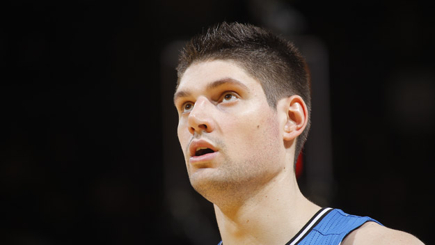 OAKLAND, CA - MARCH 18: Nikola Vecevic #9 of the Orlando Magic while facing the Golden State Warriors on March 18, 2014 at Oracle Arena in Oakland, California.  (Photo by Rocky Widner/NBAE via Getty Images)