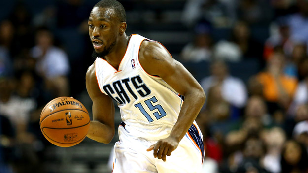 CHARLOTTE, NC - APRIL 28:  Kemba Walker #15 of the Charlotte Bobcats against the Miami Heat in Game Four of the Eastern Conference Quarterfinals during the 2014 NBA Playoffs at Time Warner Cable Arena on April 28, 2014 in Charlotte, North Carolina. (Photo by Streeter Lecka/Getty Images)