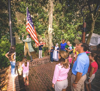 (Raising the thirteen-star flag in the courtyard of the Betsy Ross House, 239 Arch Street.  Photo provided)
