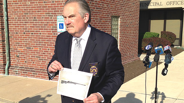 (Abington police chief Bill Kelly shows a photo of the BB gun that was seized.  Kelly photo by Justin Udo)