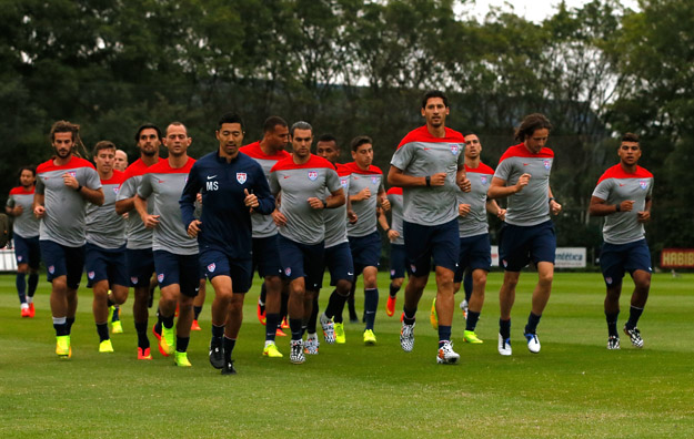 SAO PAULO, BRAZIL - JUNE 09:  The US Men's National Team jogs during their training session at Sao Paulo FC on June 9, 2014 in Sao Paulo, Brazil.