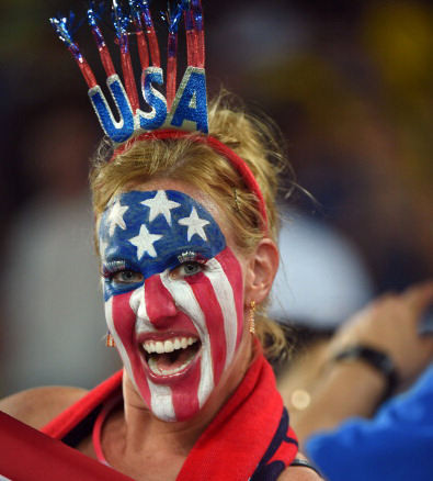 An US fan cheers before a Group G football match between Ghana and US (credit: EMMANUEL DUNAND/AFP/Getty Images)
