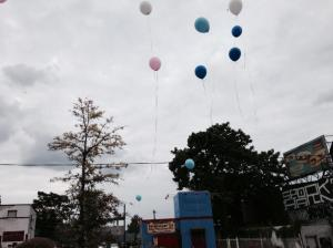 Balloons released in honor of victims at Germantown and Allegheny. (credit: Tim Jimenez/KYW)