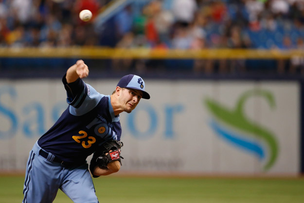 ST PETERSBURG, FL - JUNE 21:   Jake Odorizzi #23 of the Tampa Bay Rays pitches during the first inning against the Houston Astros at Tropicana Field on June 21, 2014 in St Petersburg, Florida.