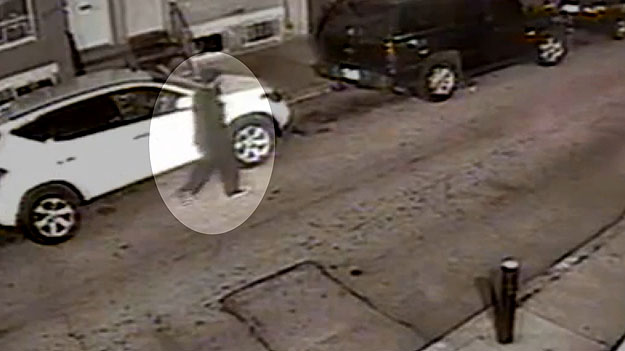 (Surveillance video captured the image of a man sought in connection with the April 2013 murder.  Image from Phila. PD video)