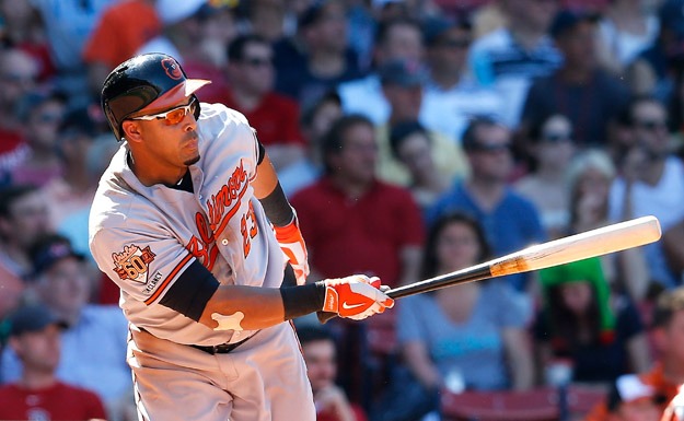 BOSTON, MA - JULY 6:  Nelson Cruz #23 of the Baltimore Orioles singles in a run against the Boston Red Sox in the seventh inning at Fenway Park on July 6, 2014 in Boston, Massachusetts.