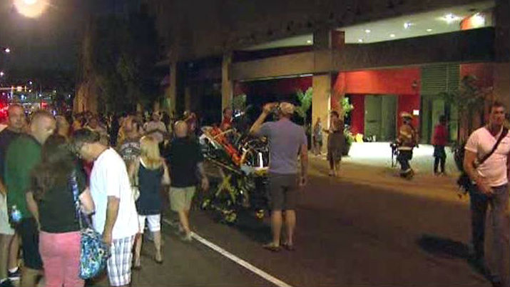 Hundreds of people wait outside the Sheraton Hotel in Center City due to a smoke evacuation.  (Credit: CBS)