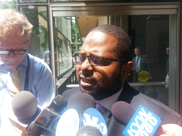 (Former judge Willie Singletary speaks with reporters after his acquittal on corruption charges in federal court.  He was convicted of lying to investigators.  Photo by Steve Tawa)