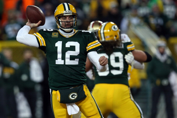 Aaron Rodgers #12 of the Green Bay Packers looks to throw against the San Francisco 49ers during their NFC Wild Card Playoff game at Lambeau Field on January 5, 2014 in Green Bay, Wisconsin.  (Photo by Jonathan Daniel/Getty Images)