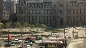 (Workers put finishing touches on a section of Dilworth Plaza, now renamed Dilworth Park, in the shadow of Philadelphia City Hall.)