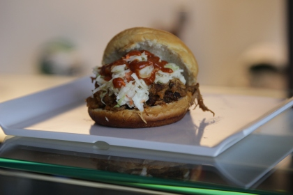 The Quick & Carmichael--black cherry smoked pulled pork, maple sugar smoked pulled chicken, topped with house made slaw, on a potato roll (Photo credit: Philadelphia Eagles)