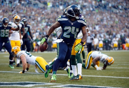 SEATTLE, WA - SEPTEMBER 04: Running back Marshawn Lynch #24 of the Seattle Seahawks scores a touchdown during the second quarter of the game against the Green Bay Packers at CenturyLink Field on September 4, 2014 in Seattle, Washington.  (Photo by Otto Greule Jr/Getty Images)