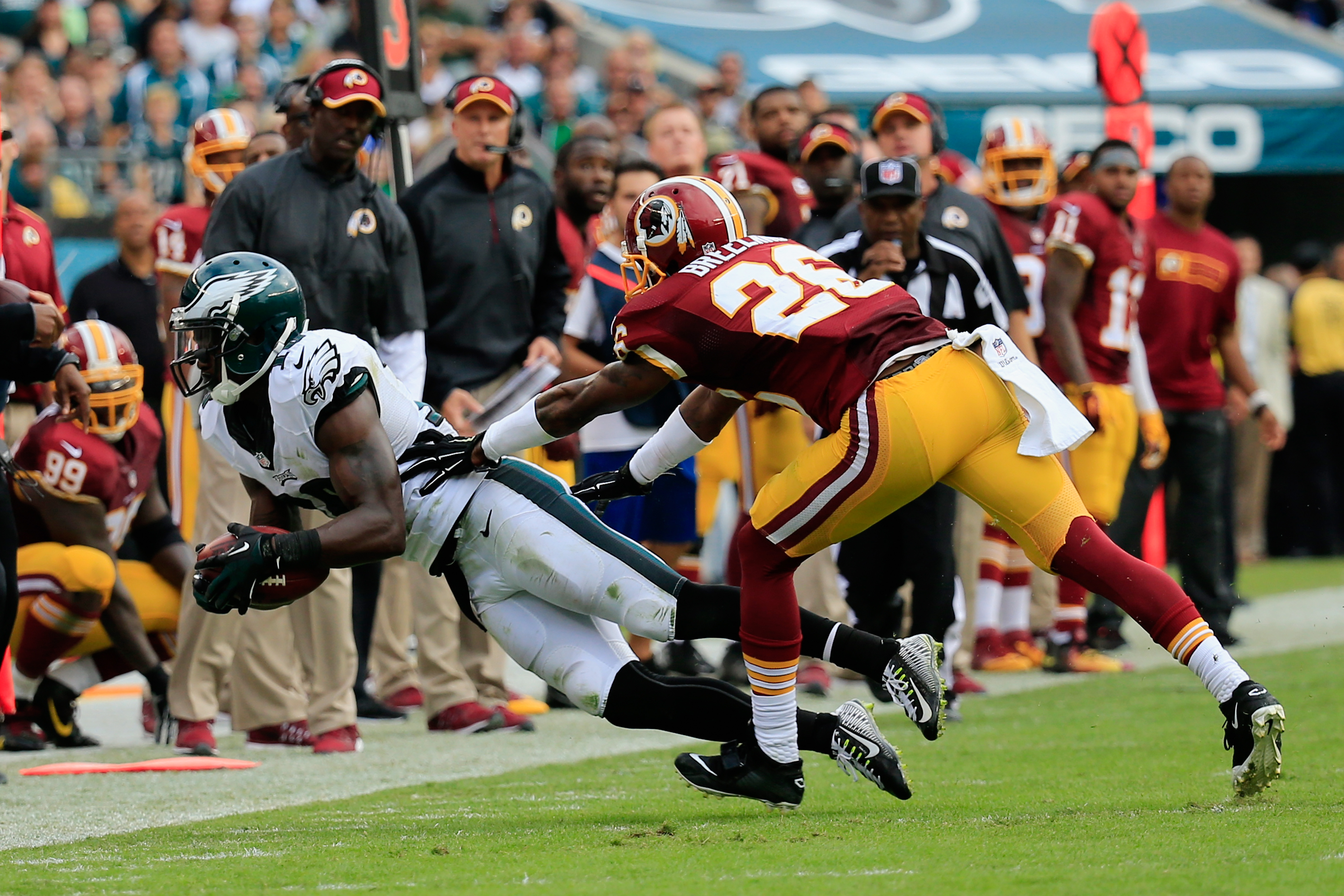 PHILADELPHIA, PA - SEPTEMBER 21:  Jeremy Maclin #18 of the Philadelphia Eagles catches a first-down pass against  Bashaud Breeland #26 of the Washington Redskins in the fourth quarter at Lincoln Financial Field on September 21, 2014 in Philadelphia, Pennsylvania.  (Photo by Rob Carr/Getty Images)