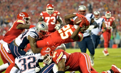 KANSAS CITY, MO - SEPTEMBER 29:   Jamaal Charles #25 of the Kansas City Chiefs dives in for a touchdown against the New England Patriots during the second quarter at Arrowhead Stadium on September 29, 2014 in Kansas City, Missouri.  (Photo by Peter Aiken/Getty Images)