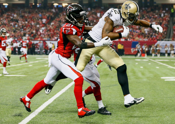 ATLANTA, GA - SEPTEMBER 07: Marques Colston #12 of the New Orleans Saints is tackled by Desmond Trufant #21 of the Atlanta Falcons in the first half at the Georgia Dome on September 7, 2014 in Atlanta, Georgia. The Atlanta Falcons won 37-34. (Photo by Kevin C. Cox/Getty Images)