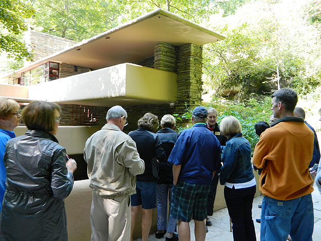 "(A tour group takes in Frank Lloyd Wright's ""Fallingwater.""  Photo by Jay Lloyd)"