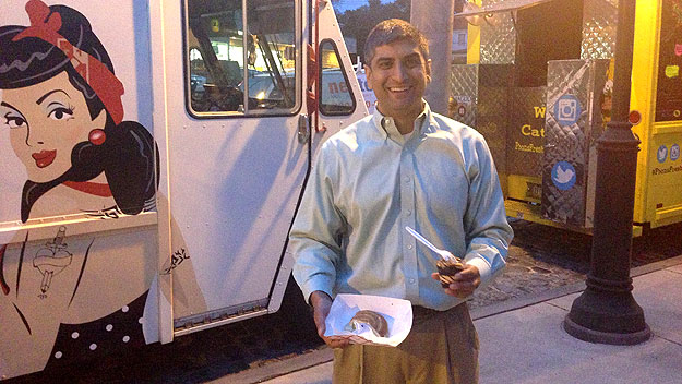 "(Anuj Gupta, executive director of Mt. Airy USA, on Germantown Ave at media preview for ""Mt. Airy Street Fare: Sip, Savor, Stroll.""  Photo by Hadas Kuznits)"